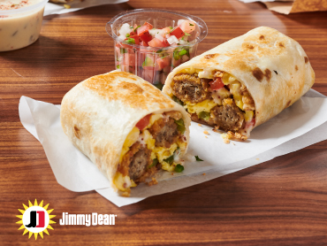 Jimmy Dean® Sausage Tots in a warmed flour tortilla filled with scrambled eggs, fried onion straws, roasted red and green bell pepper strips with queso blanco and fresh-made pico de gallo.